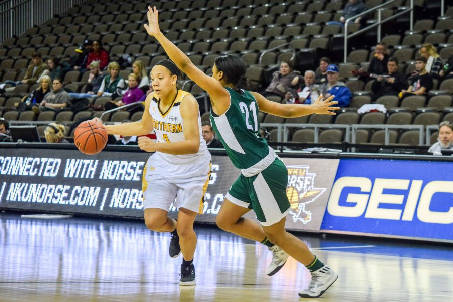 Mikayla Terry (4) drives around a defender during Thursday's game against Cleveland State.