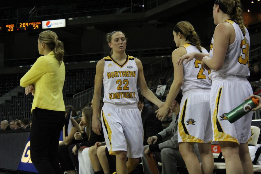 Kelley Wiegman high fives teammates on the bench in her final home game at BB&T Arena on Sunday.