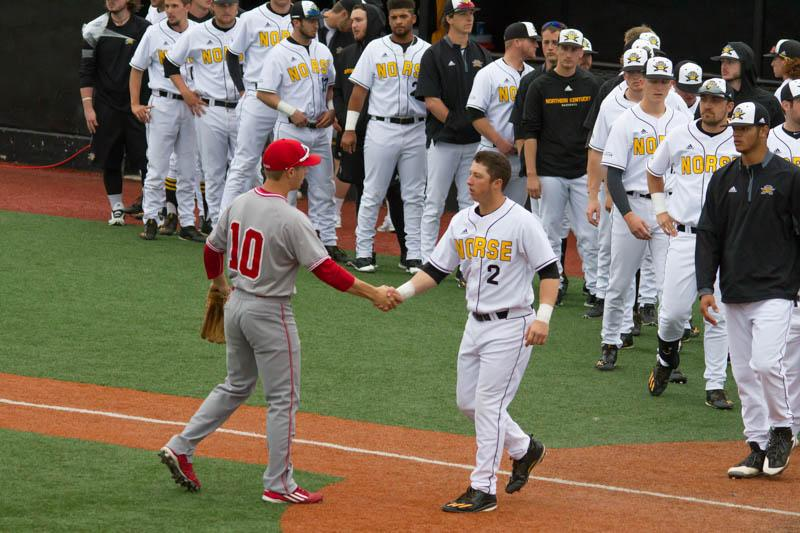 Kyle+Colletta+%282%29+and+Brooks+Urich+%2810%29+shake+hands+in+front+of+home+plate.+