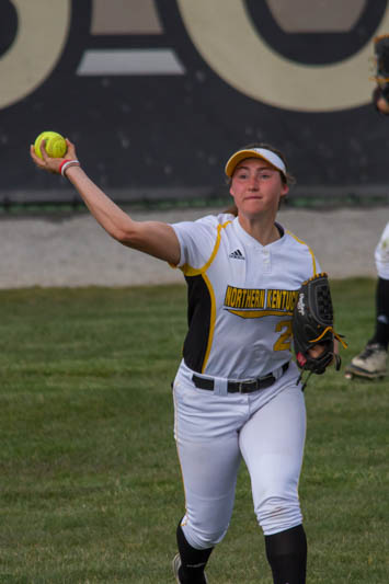 Outfielder Ava Lawson throws the ball back into the infield to keep runners from advancing .