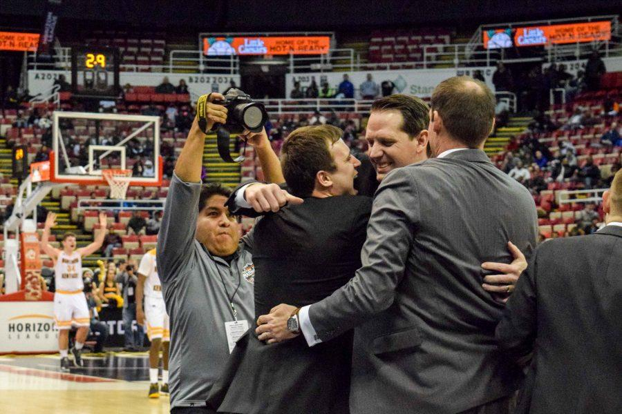 The NKU coaching staff celebrates as the Norse prepare to clinch their first Horizon League championship and NCAA tournament bid.