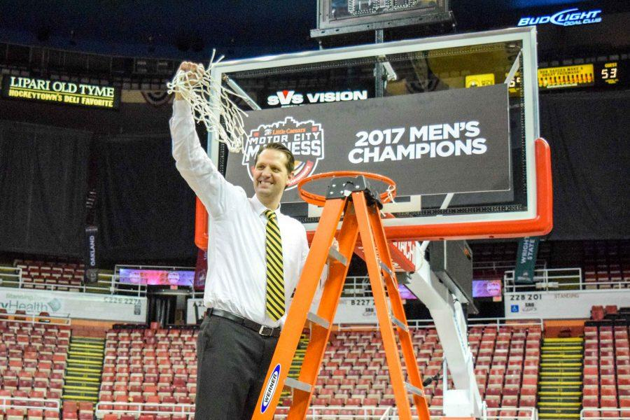 NKU head coach John Brannen celebrates after cutting the nets down at Joe Louis Arena.