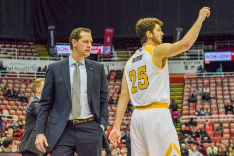 NKU head coach John Brannen talks to Cole Murray during Sunday's Horizon League tournament quarterfinal against Wright State.
