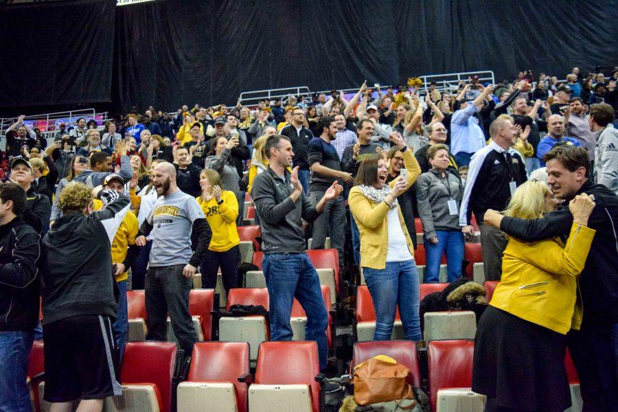 The NKU fans who made the trip to Detroit celebrate the victory.