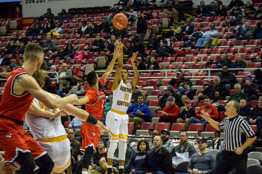 Mason Faulkner (11) shoots a three during Monday's Horizon League semifinal win over Youngstown State.