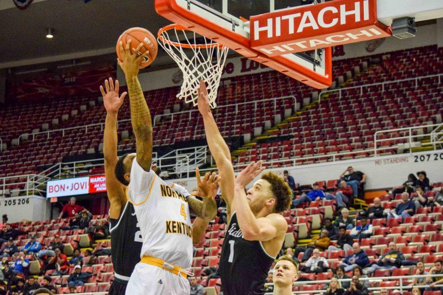 Jeff Garrett (4) gets his own rebound and scores during Sunday's Horizon League quarterfinal game against Wright State.