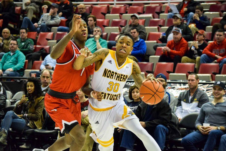 Lavone Holland II (30) drives around a defender during NKU's Horizon League semifinal win Monday night over Youngstown State.