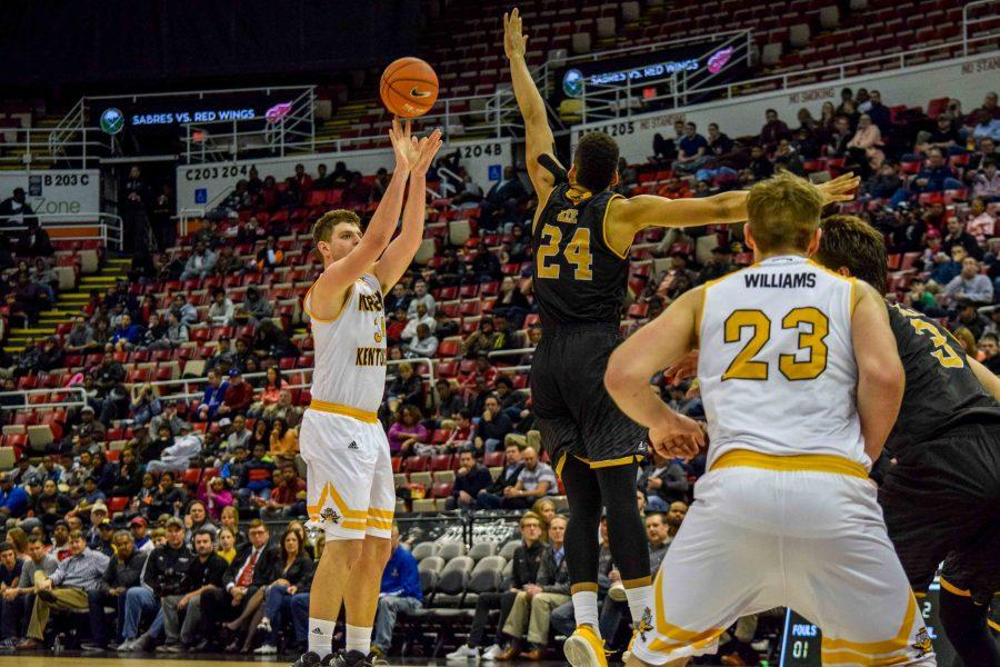 Drew McDonald (34) makes a three  during the Horizon League championship game against Milwaukee.