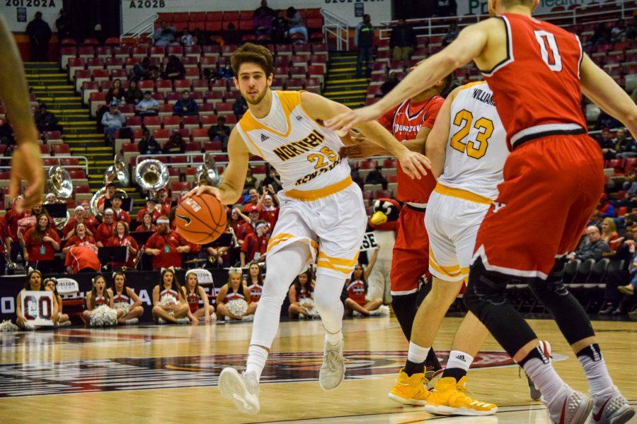 Cole Murray (25) is grabbed as he goes around defenders during Monday's Horizon League semifinal win over Youngstown State.