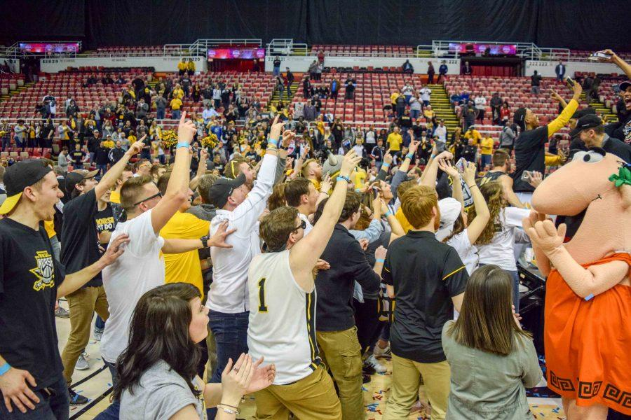 NKU students rush the state to celebrate with the men's basketball team.