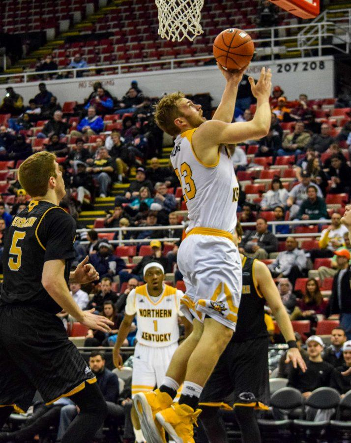 Carson Williams (23) goes up for a shot during the Horizon League championship game against Milwaukee.