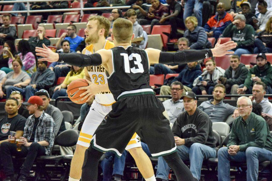 Carson Williams (23) looks for a teammate during Sunday's Horizon League quarterfinal game against Wright State.