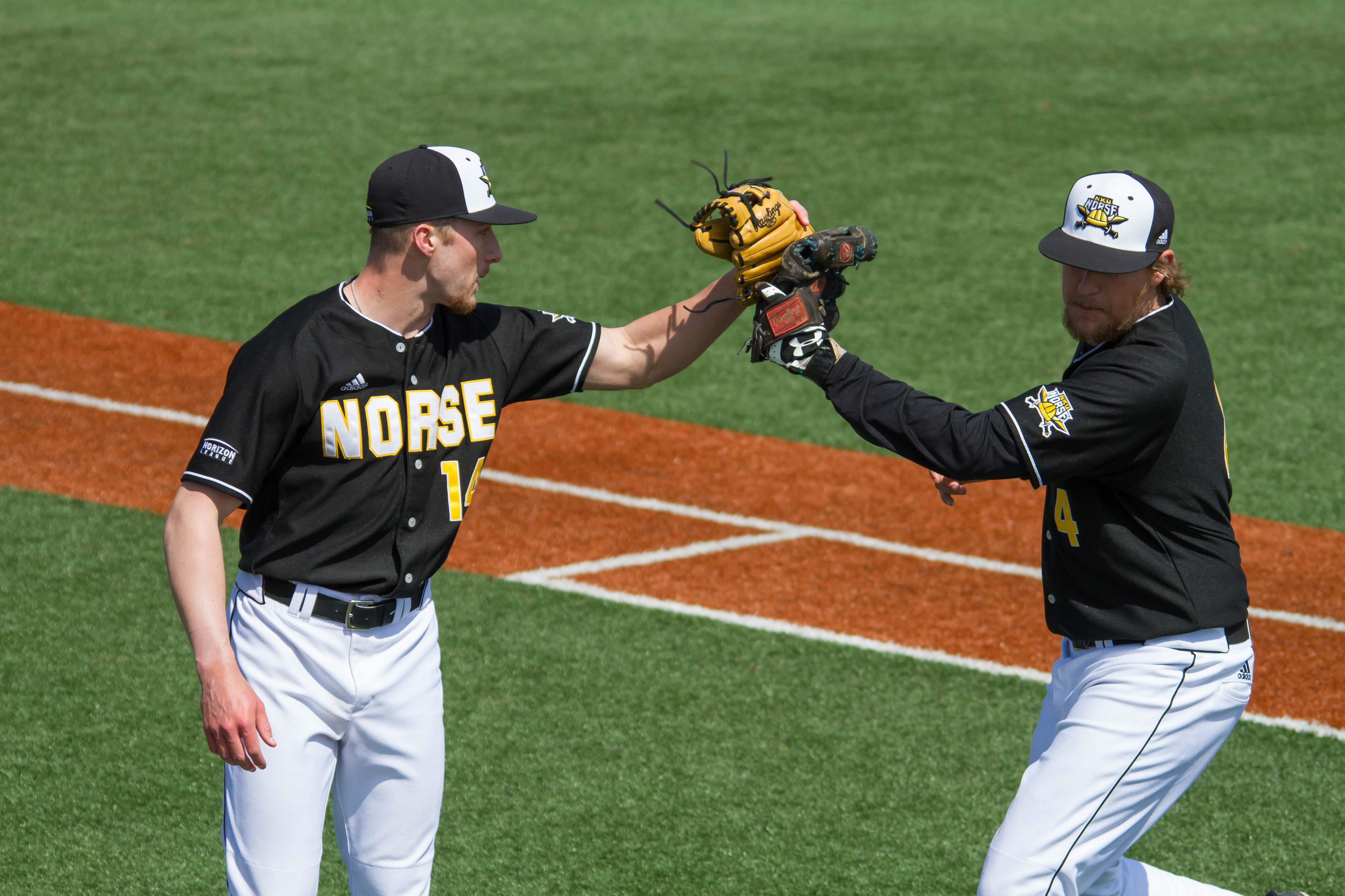 Cameron Ross (14) and Dominic Mercurio (4) slap gloves after an inning. Ross didn't allow a run in 2.2 innings of work