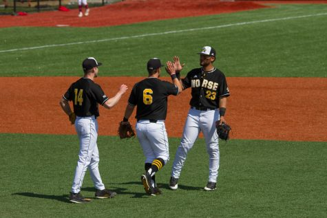 Cameron Ross (14), Brad Bohlen (6) and Trey Ganns (23) shake hands after Sunday's win over Youngstown State.