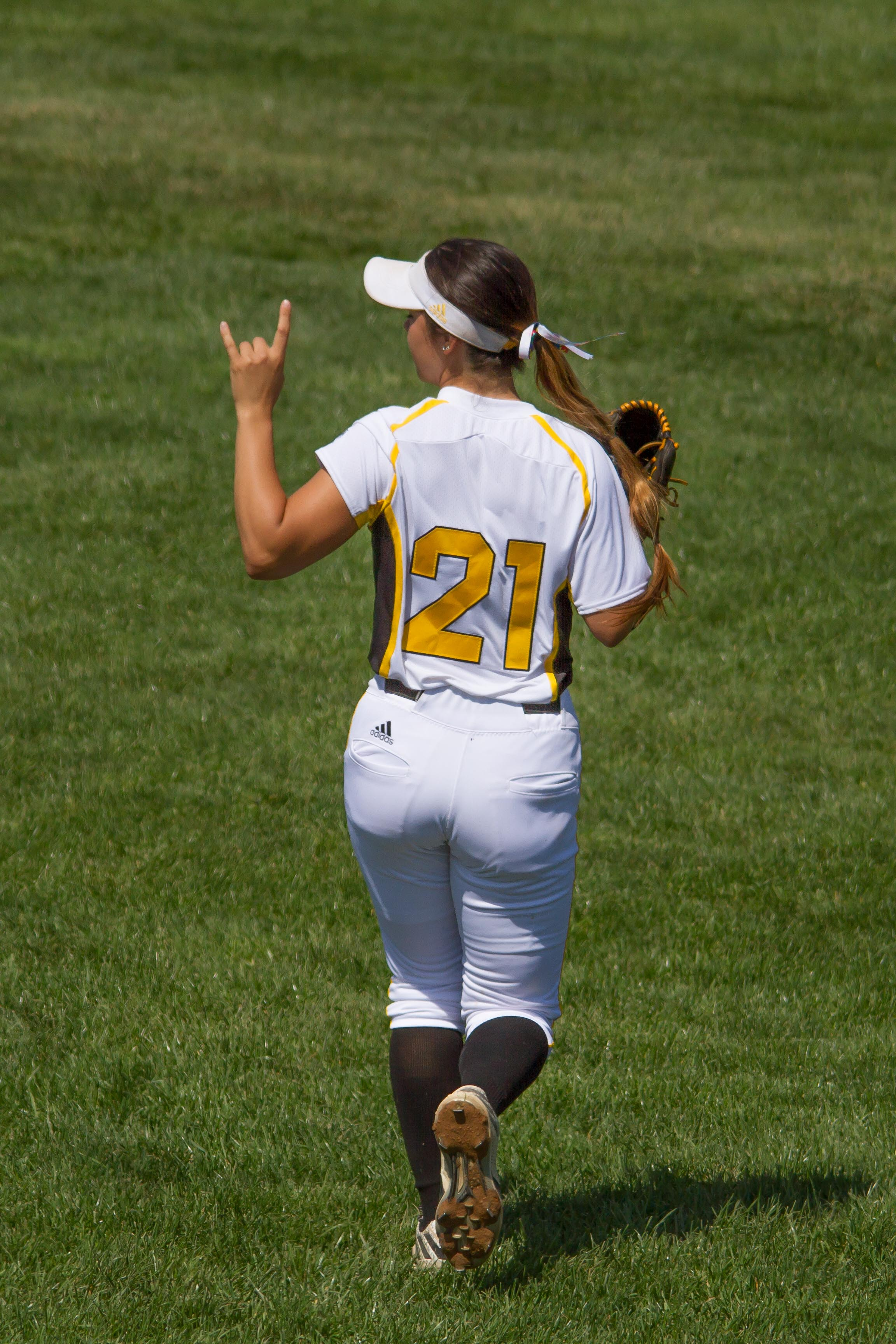 Kailey+Rossiter+signals+two+outs+to+the+rest+of+the+Norse+outfield