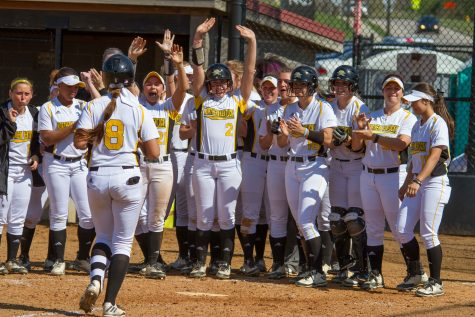 The Norse celebrate after Dani Devlin homered against Youngstown State