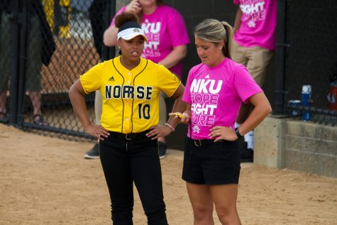 Morgan Glover (10) talks with assistant coach Shana Madura during Thursday's game against Green Bay.