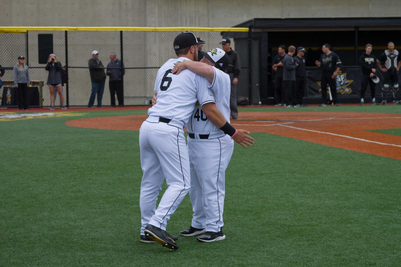 Brad+Bohlen+%286%29+hugs+Ryan+Mavriplis+on+his+way+out+to+the+field