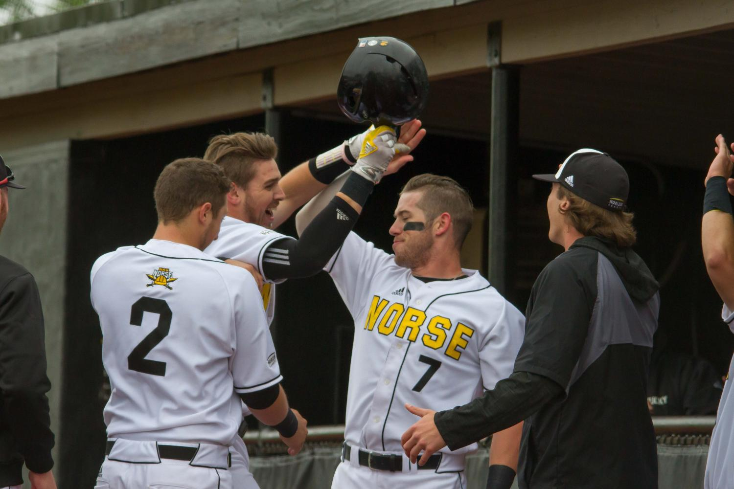 TJ Alas (7) celebrates Will Haueter's homerun against Oakland