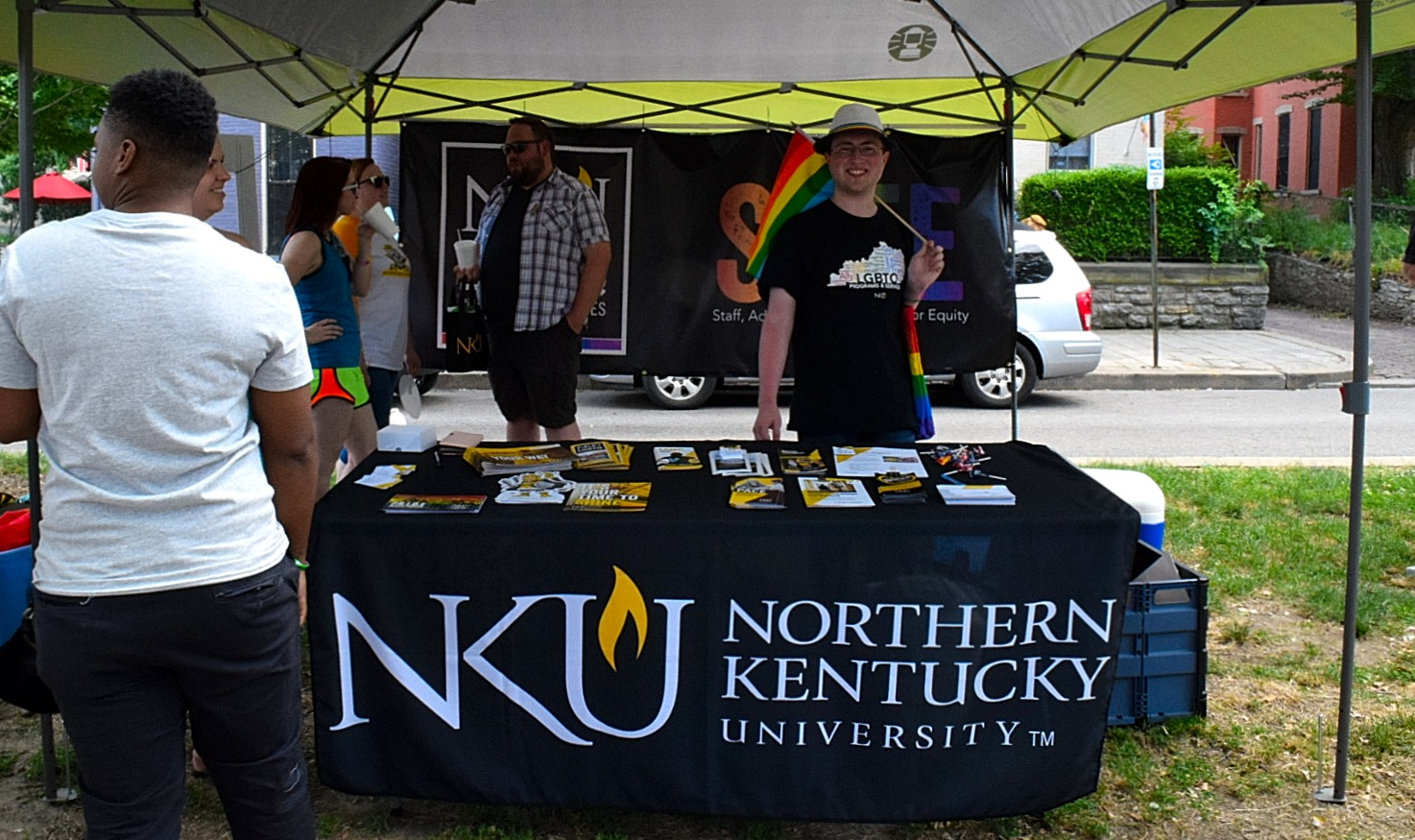 Noah Pittinger handed out resources at NKU's booth. Rainbow flag in hand, he hope everyone can one day be themselves.