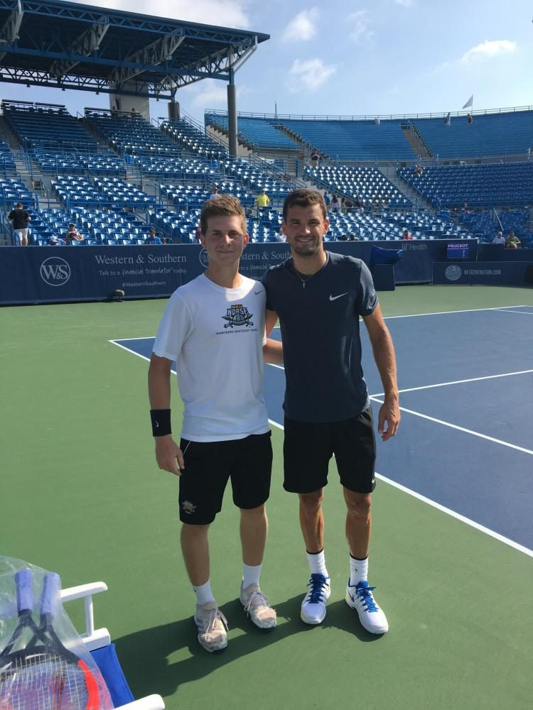 Mate Virag stands with Grigor Dimitrov, who won the Western and Southern Open