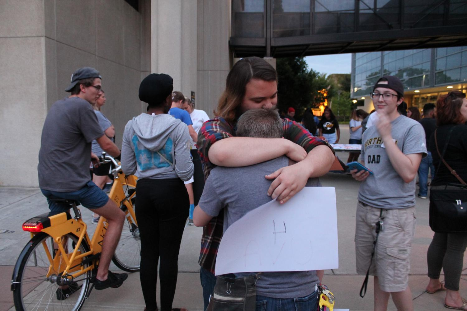 Many attendees hugged one another, speaking words of support. The sign that student Nova Grace holds reads