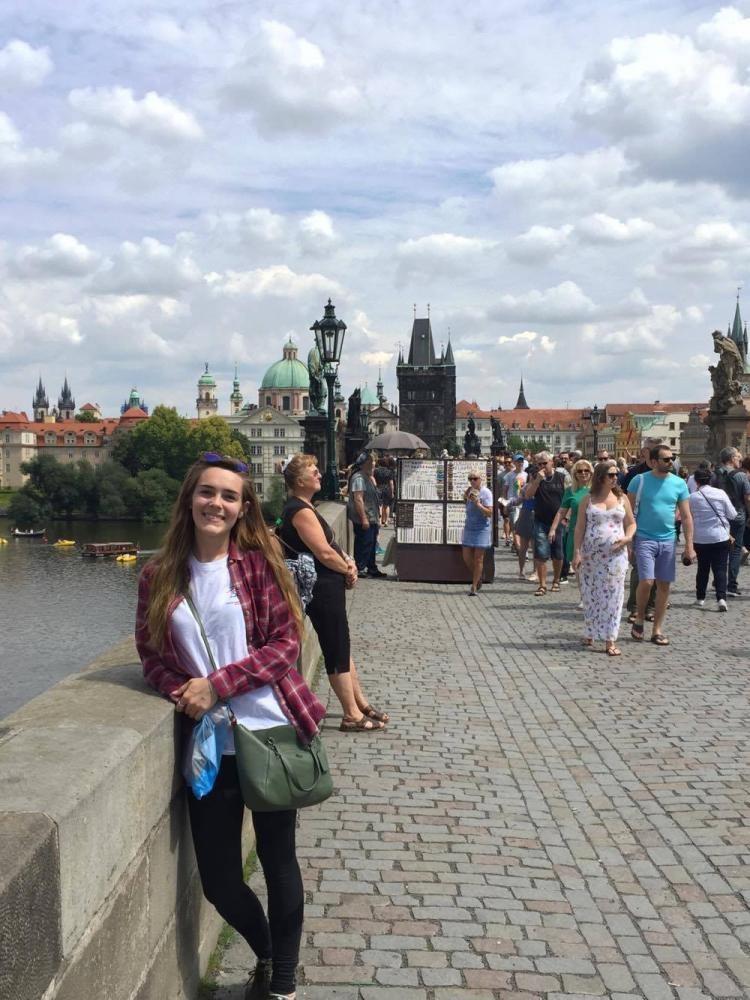 Helton posing for a photo on her summer trip through the KIIS Munich program.