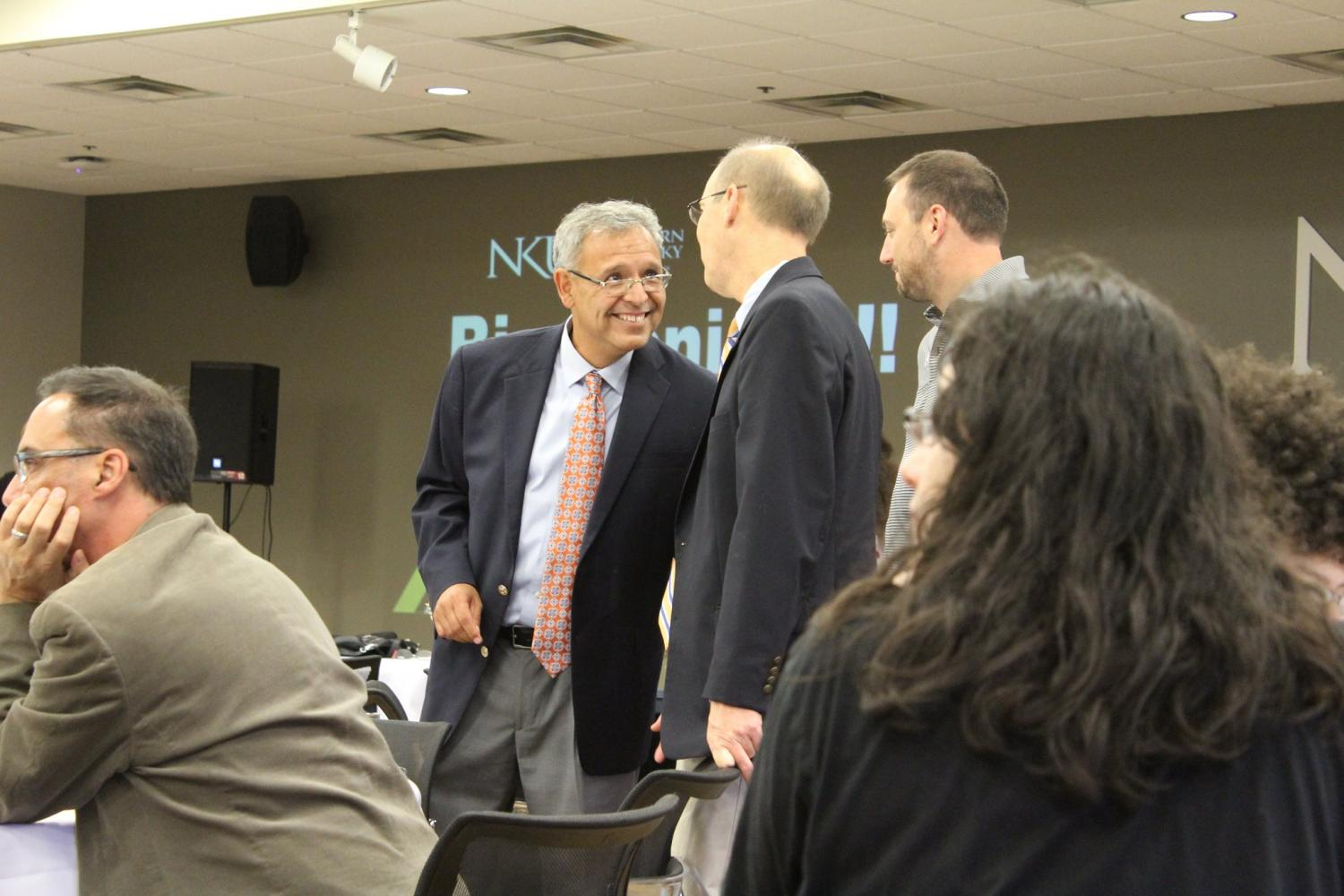 The director of Latino programs and Services mingled with attendees.