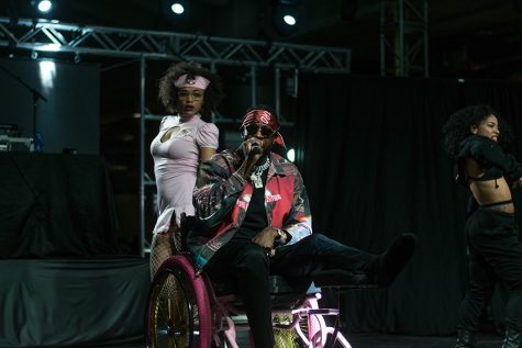 2 Chainz rolled around the stage in a wheelchair after breaking his leg in August.