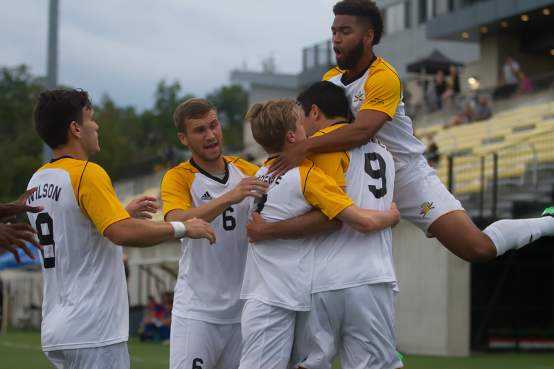 NKU players celebrate after a goal by Tom Suchecki (9)
