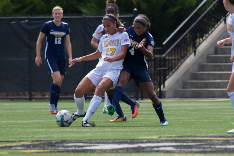 Samantha Duwel (27) prepares to pass the ball to a teammate