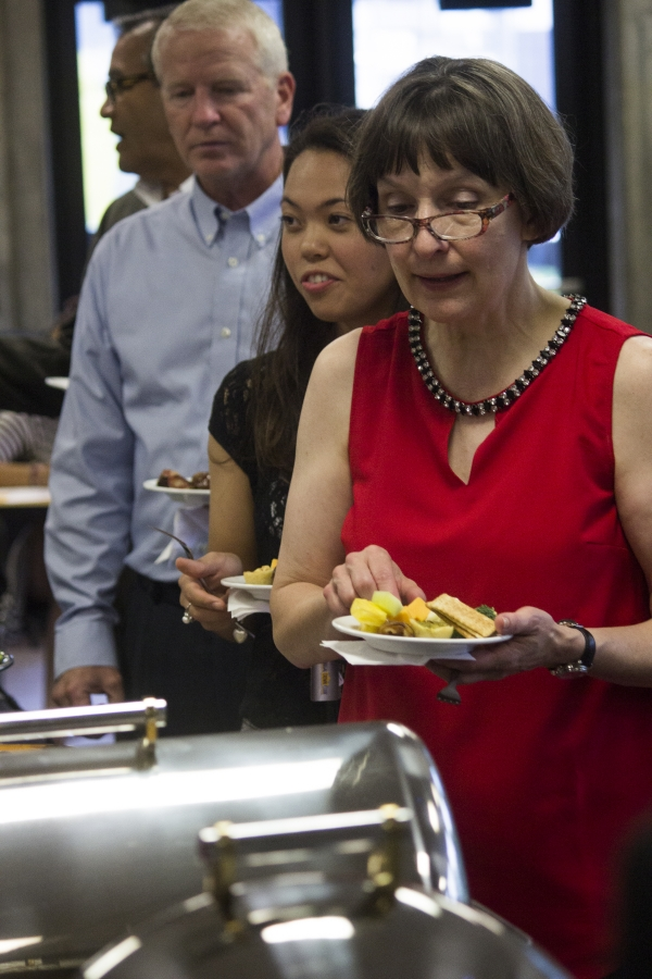 Snack food was served at the casual affair where both students and faculty mingled.