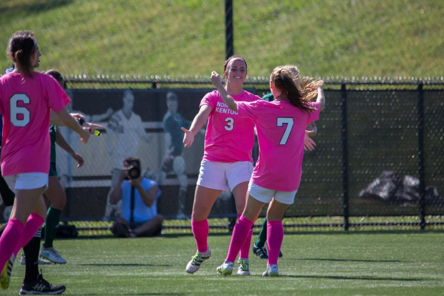 Macy Hamblin (3) and Emily Soltes (7) celebreate after a goal in the game against Green Bay