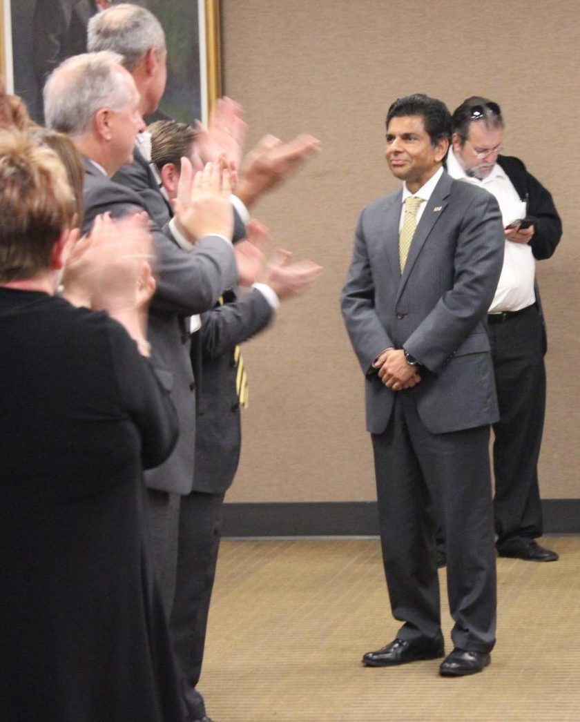 Board of Regents meeting attendants applaud as Dr. Ashish Vaidya is voted NKU's next president.
