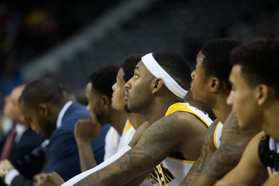 Jeff Garrett and the Norse watch the game against Wilmington. The Norse won 93-65.