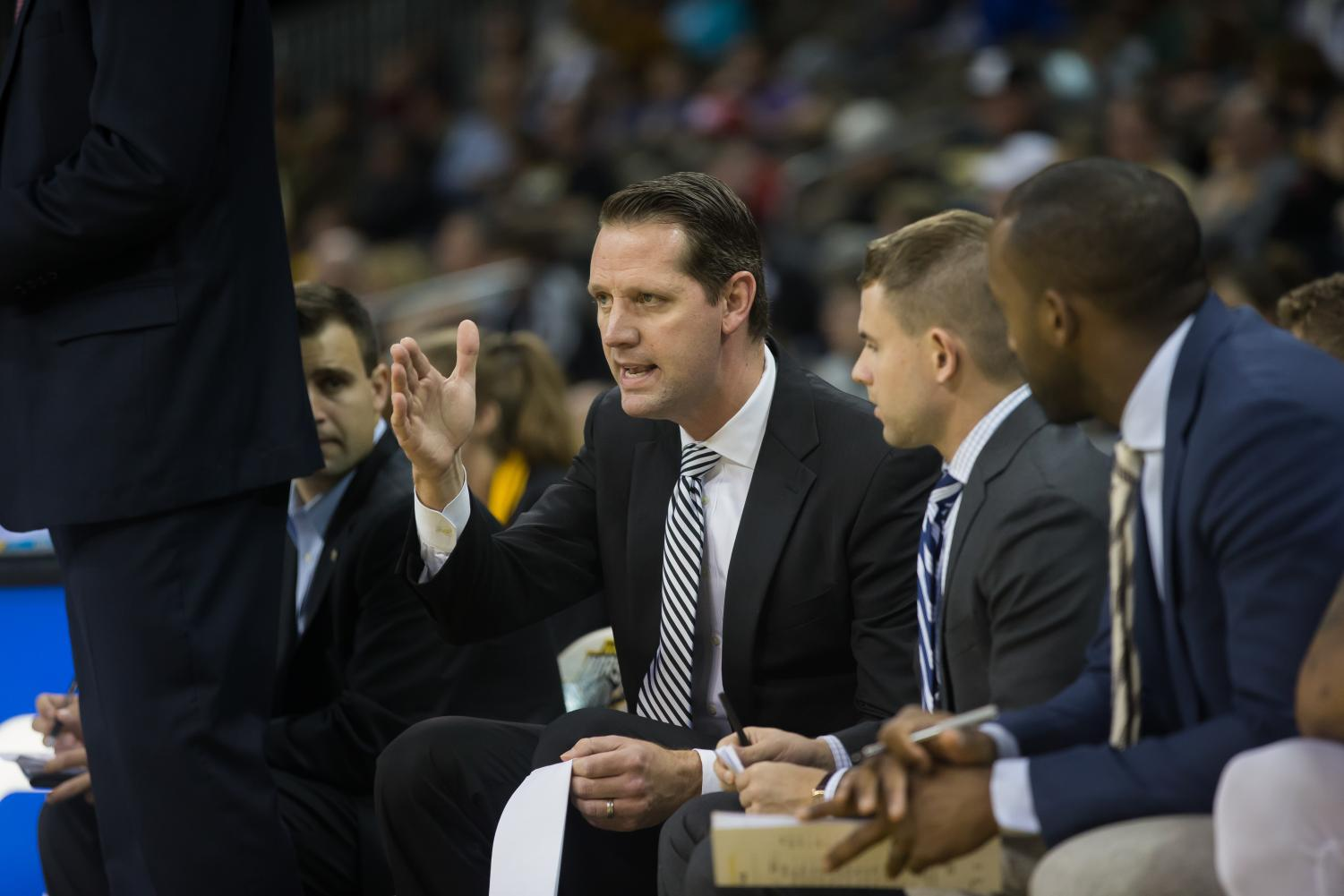 NKU+Men%27s+basketball+coaches+talk+during+the+game+against+Wilmington.