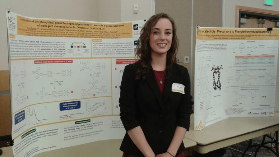 Ariel Porter, who traveled to France through STEM-IRSEP this summer, standing in front of her poster presentation.