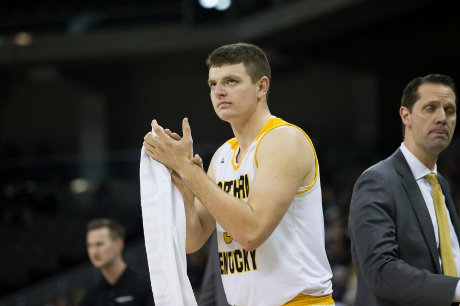 Drew McDonald (34) claps after a score by NKU.