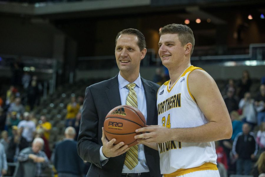 Head Coach John Brannen congratulates Drew McDonald (34) on his 1000th career point in the game against Morehead.