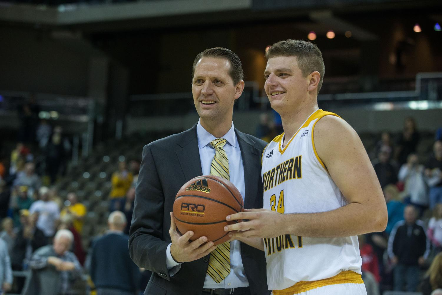 Head+Coach+John+Brannen+congratulates+Drew+McDonald+%2834%29+on+his+1000th+career+point+in+the+game+against+Morehead.+