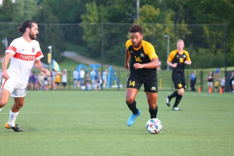 Abdul Kooistra dribbles past an defender during their match with the FC Cincinnati reserve team in August