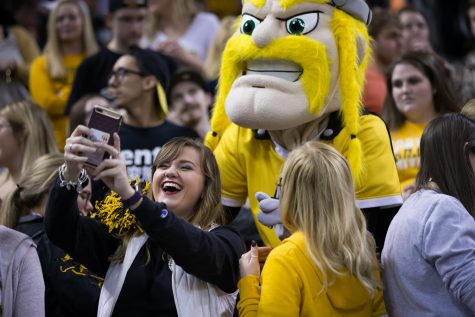 An NKU fan takes a photo with Victor.