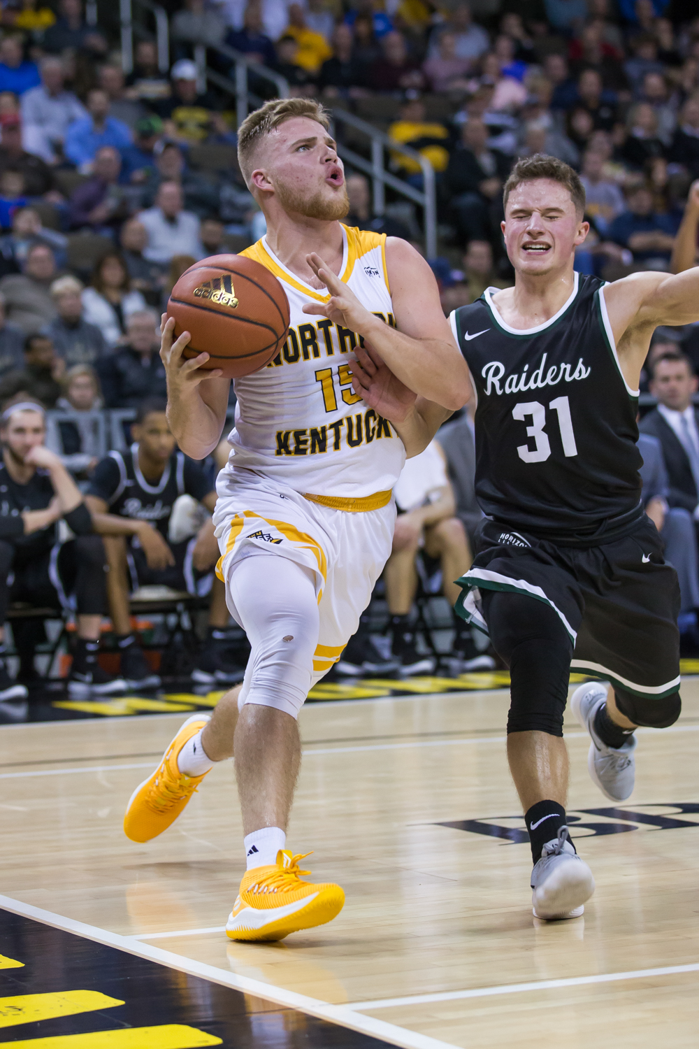 Tyler Sharpe (15) drives toward the basket in the game against Wright State.
