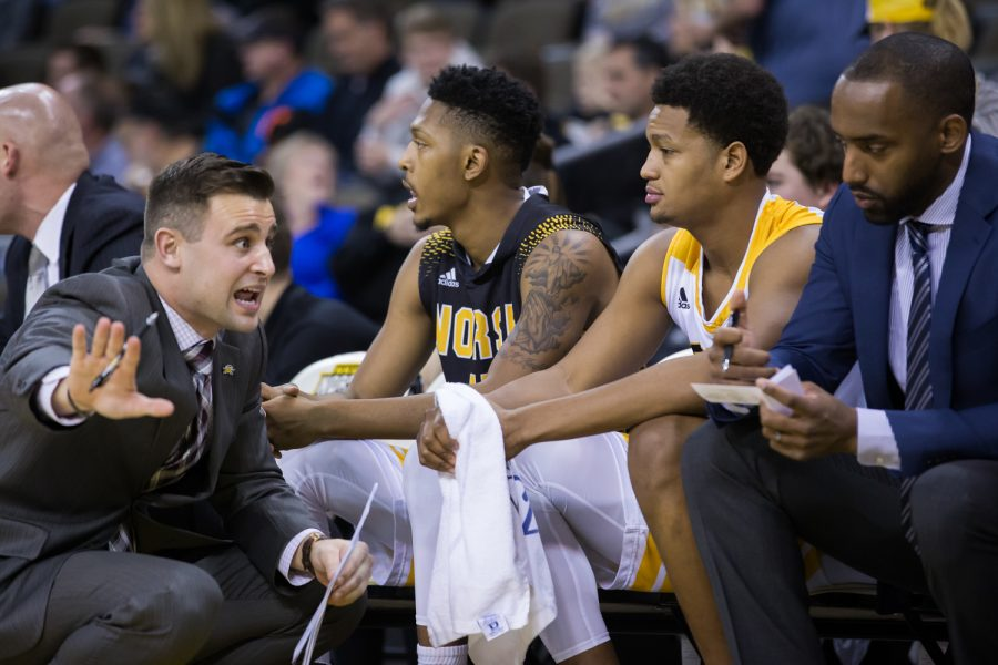 An NKU coach talks to Dantez Walton (32) during the game against Wright State.
