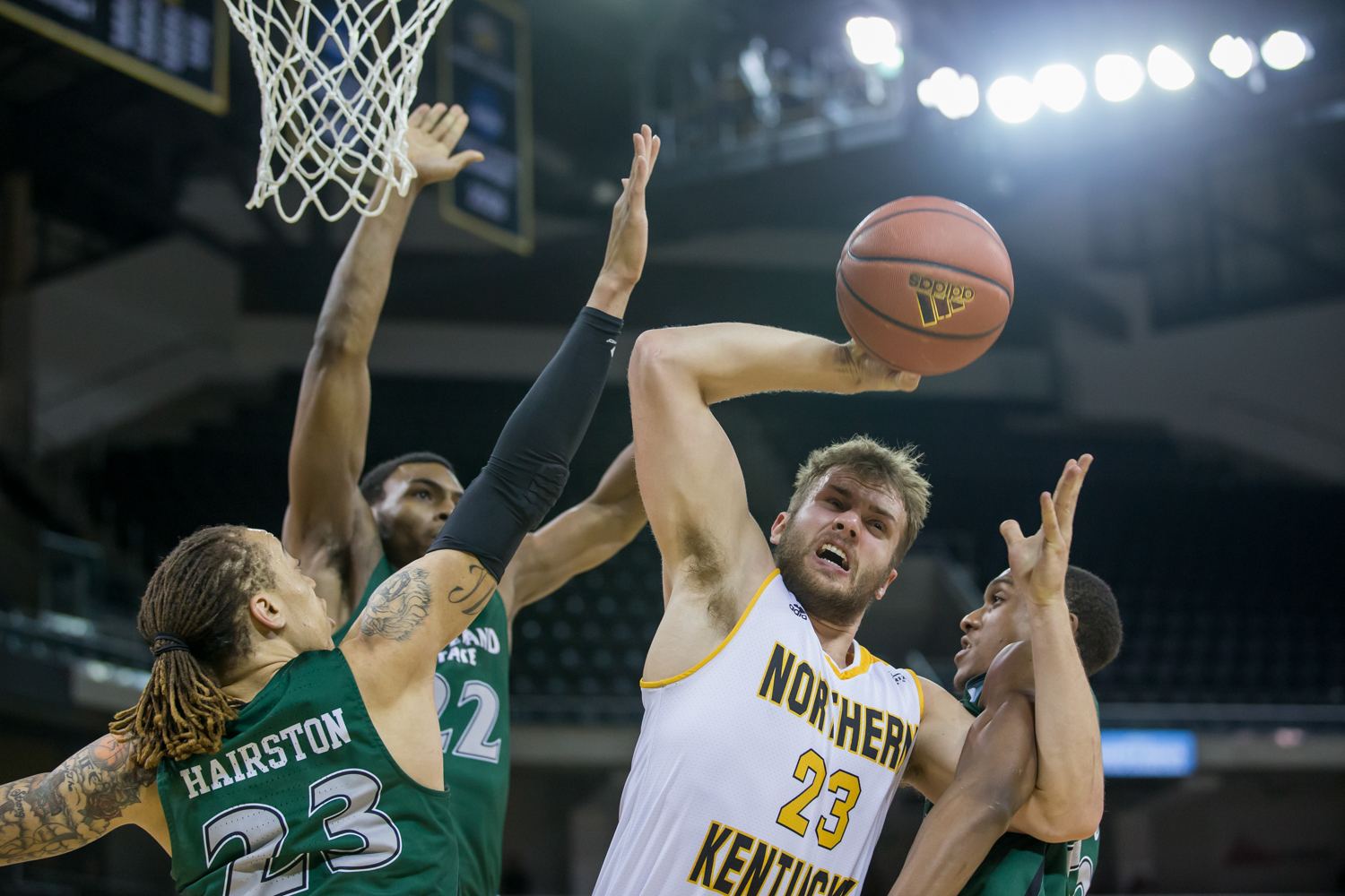 Carson Williams (23) fights to shoot under pressure in the game against Cleveland State.