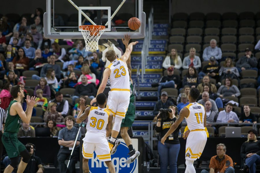Carson Williams (23) blocks a Cleveland State player's shot.