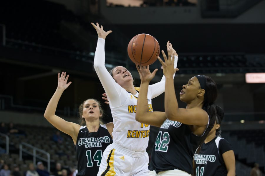 Jazmyne Geist (13) loses the ball as she goes up for a shot in the game against Cleveland State.