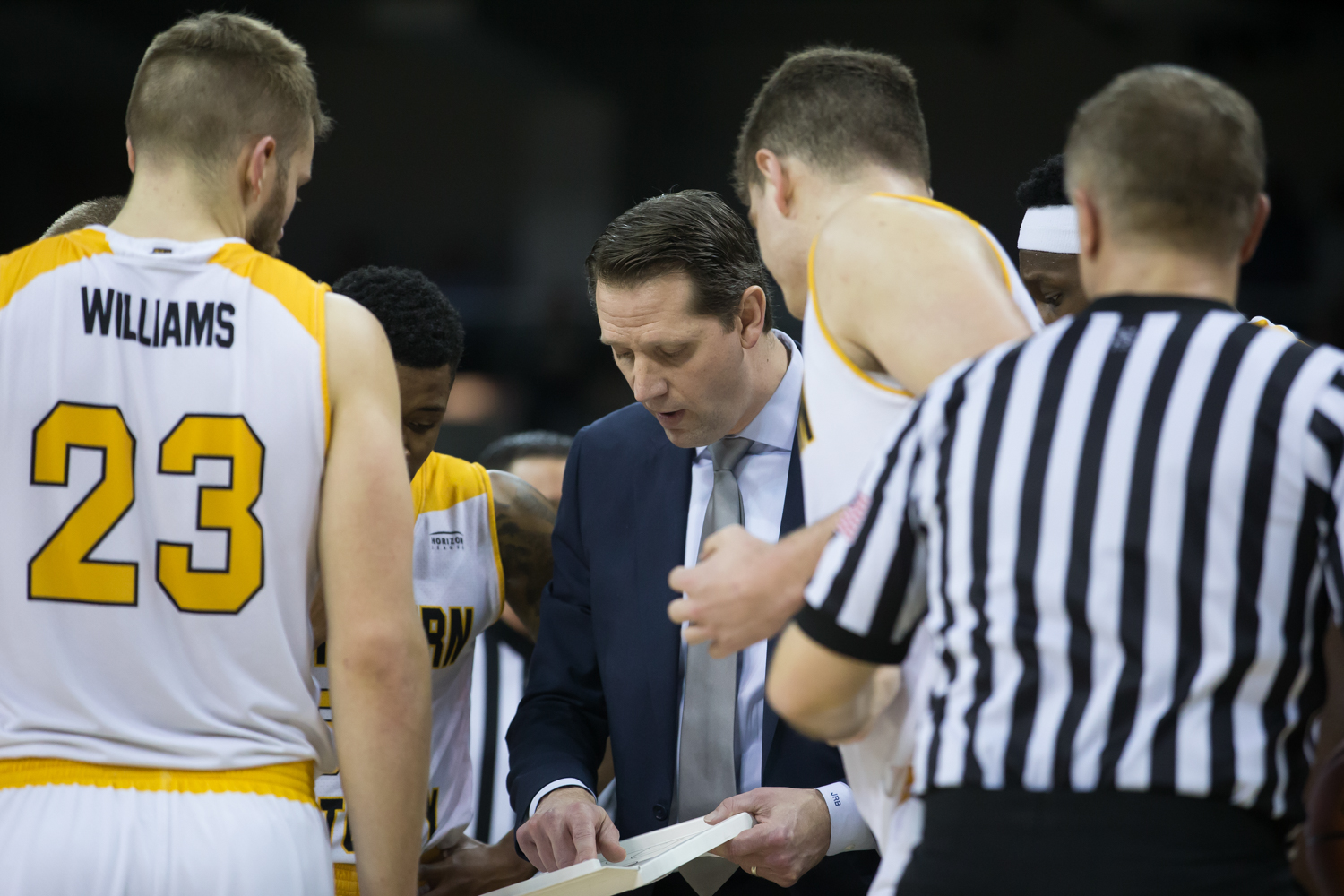 Head Coach John Brannen goes over a play during a timeout in the game against Milwaukee.