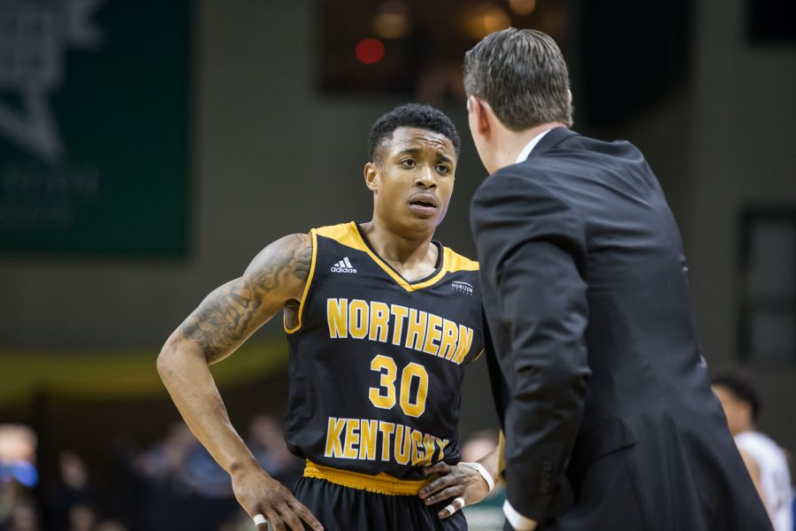 Lavone Holland II (30) talks to Head Coach John Brannen during a timeout in the game against Wright State .