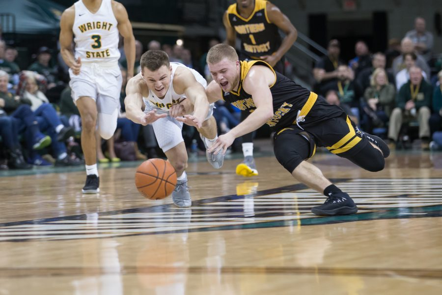 Tyler Sharpe (15) dives for a loose ball in the game against Wright State.